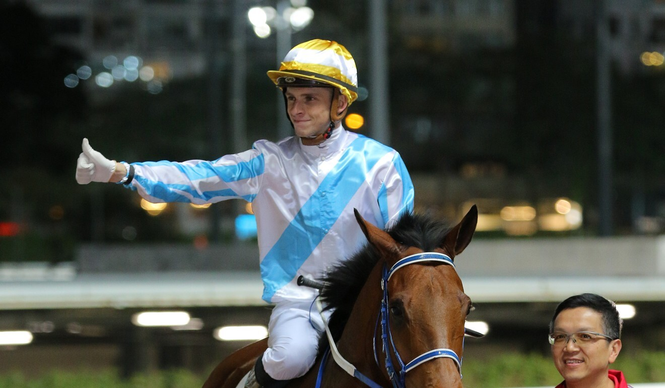 Lyle Hewitson heads for the winner's circle after saluting on Methane at Happy Valley.
