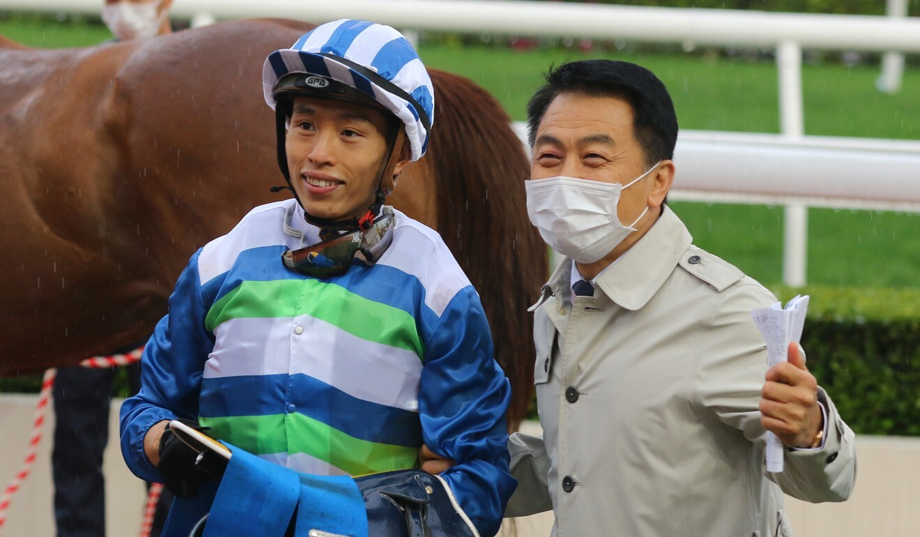 Jockey Vincent Ho (left) and trainer Ricky Yiu celebrate Voyage Warrior's win.