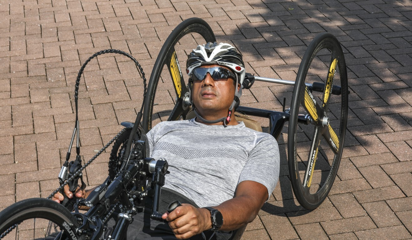 Ajmal Samuel and his handbike – a far cry from his dark drug-dependent days. Photo: Xiaomei Chen