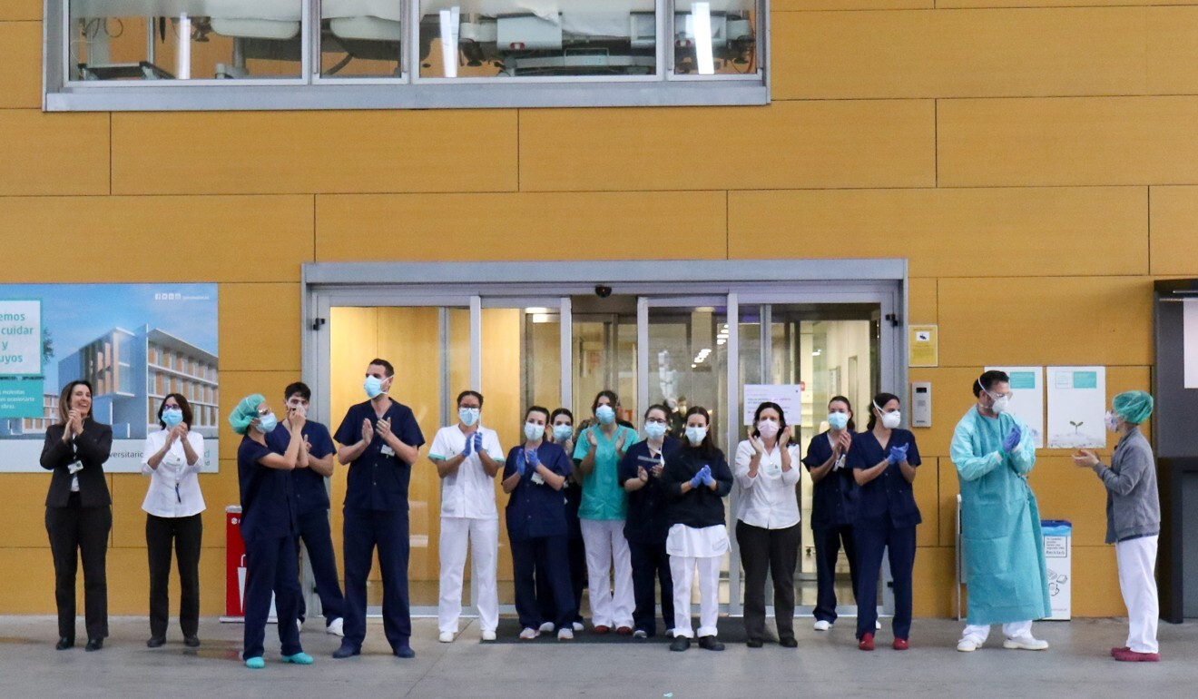 Medical staff in Spain acknowledge the daily applause from the public which has become a feature of the coronavirus pandemic. Photo: DPA
