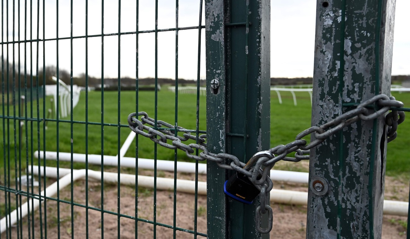 A locked gate at Aintree Racecourse, home of the annual Grand National horse racing event. Photo: AFP