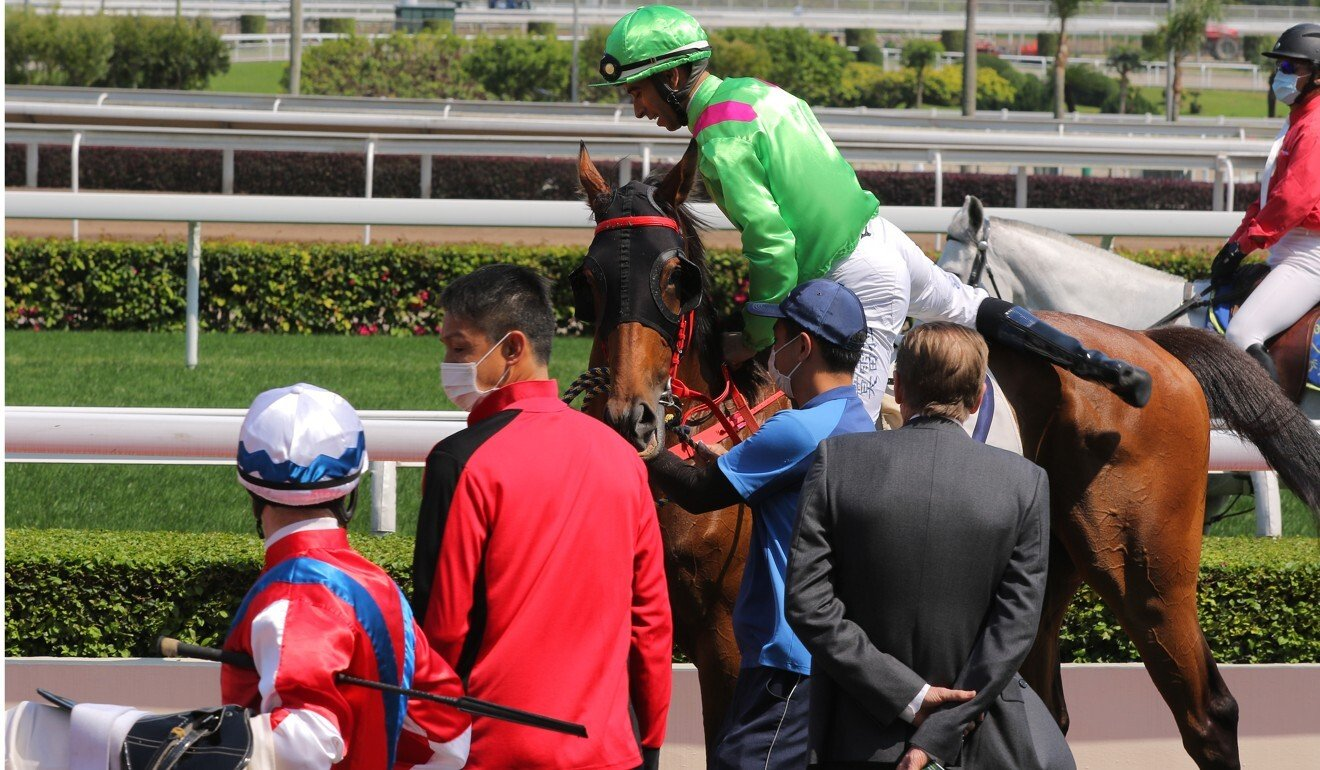 Zac Purton (left) looks over at Joao Moreira and John Size after the race.