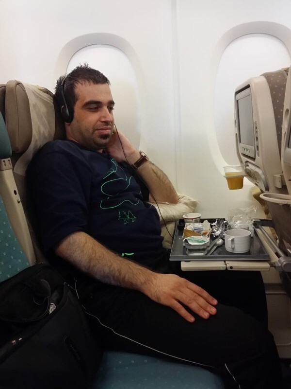 Alex Tyronne on the plane to Iraq in 2014, before his transformation. Photo: Handout