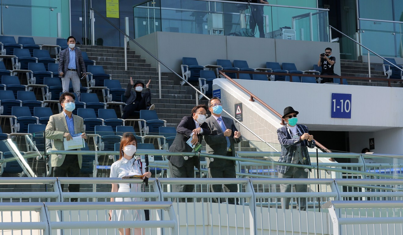 Owners at Sha Tin watch their horse race.