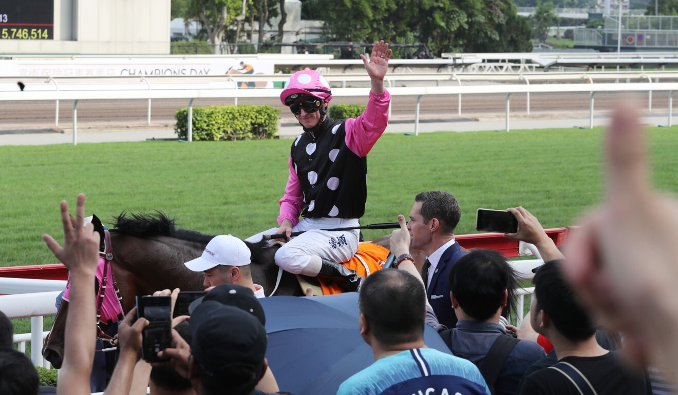 Zac Purton waves to the fans after Beauty Generation's win in the 2019 Champions Mile.