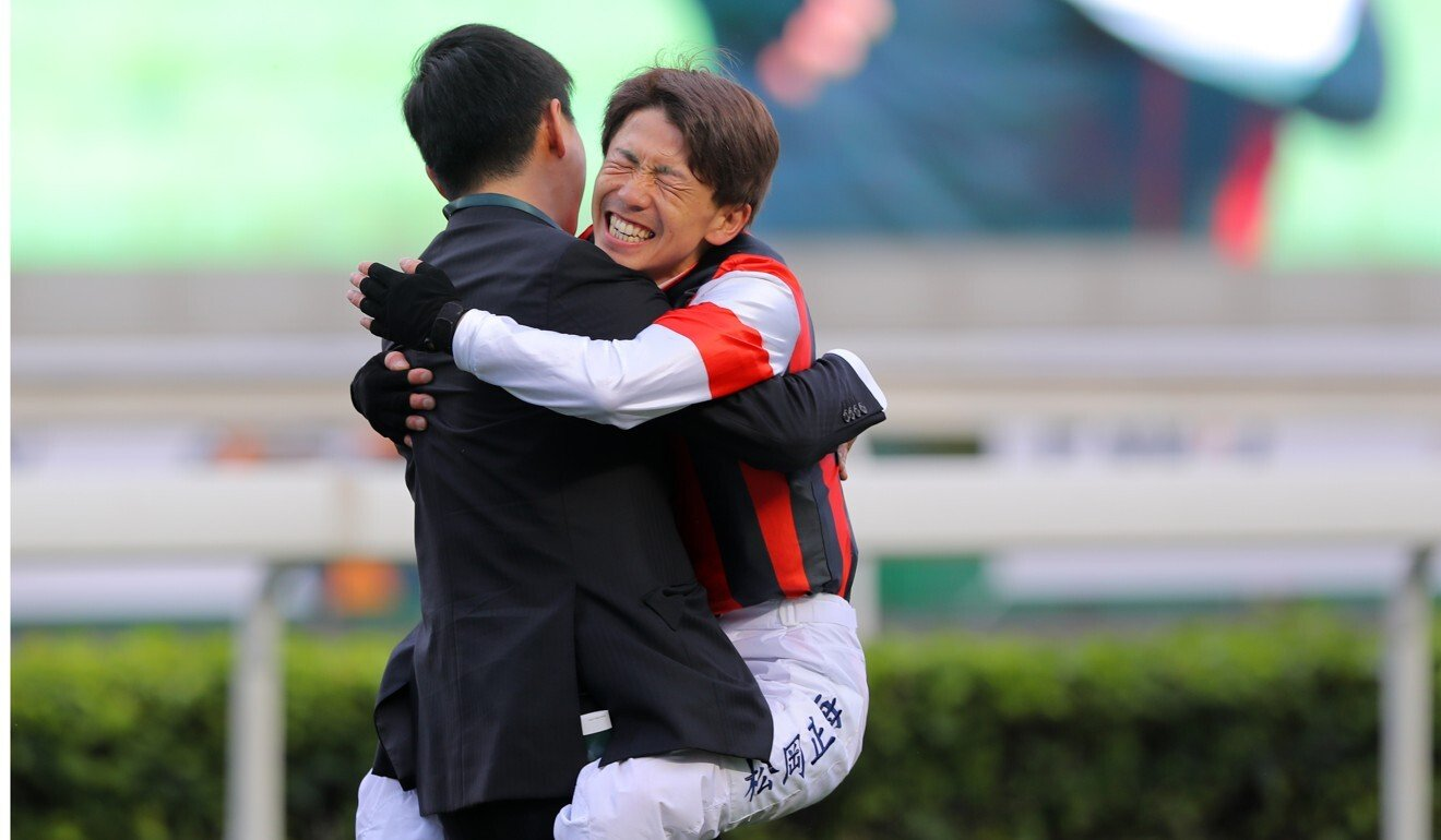 Masami Matsuoka hugs Win Bright's trainer Yoshihiro Hatakeyama after winning the QE II Cup.