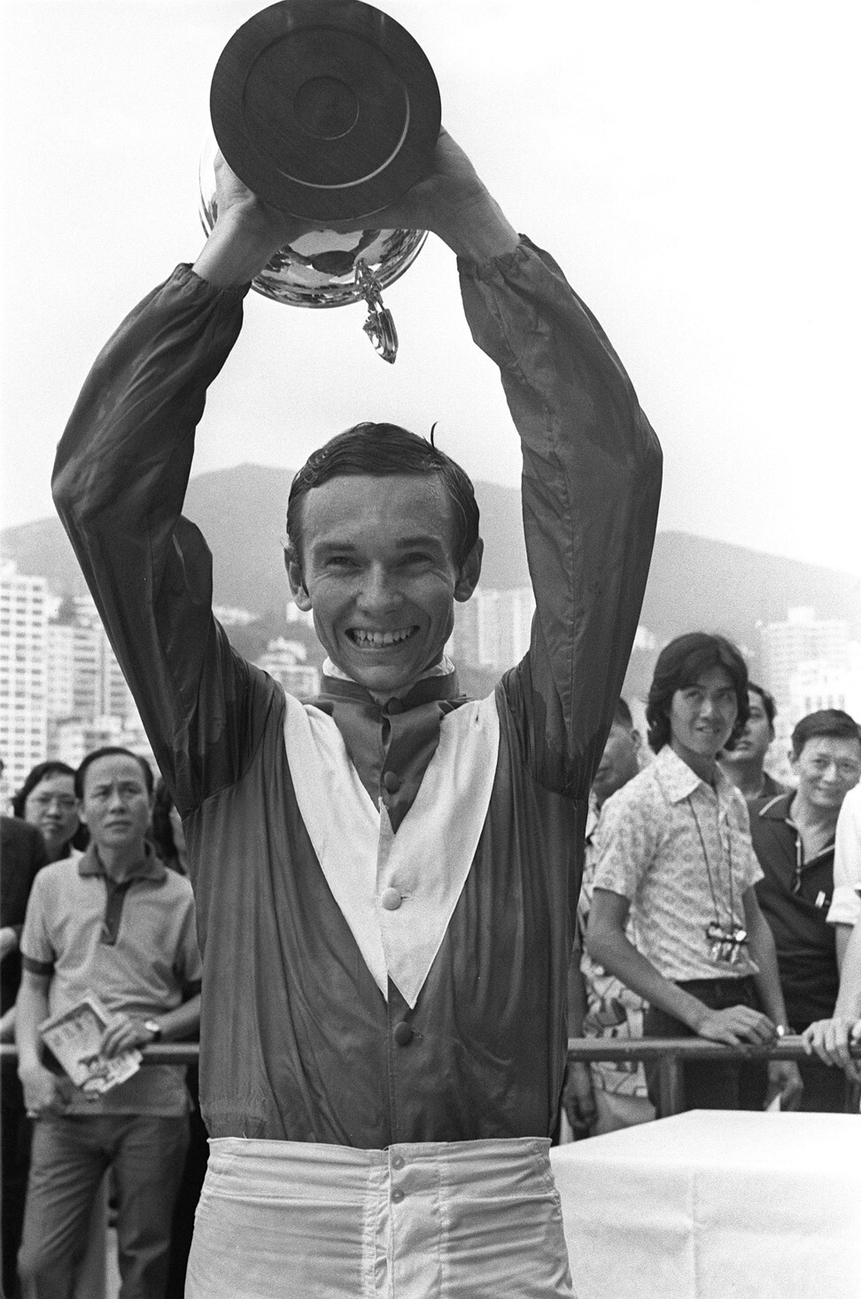 Jockey Gary Moore holds aloft the Champions & Chater Cup after winning aboard Super Win at Happy Valley. Photo: SCMP