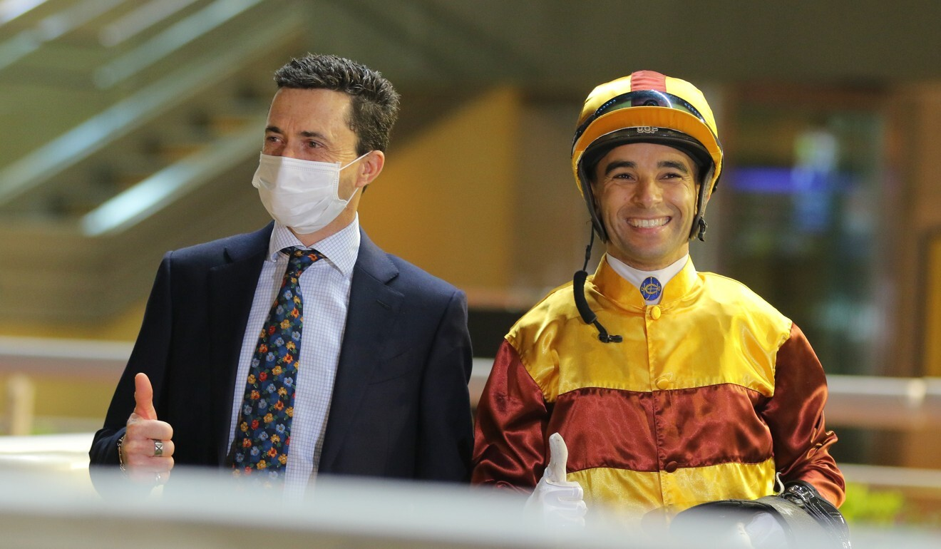 Trainer Douglas Whyte and jockey Joao Moreira celebrate Simply Fluke's win.