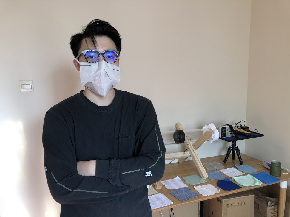 Zheng Min, a Smart Air test engineer, wearing a DIY mask made from household materials at the company's headquarters in Beijing. Photo: Orange Wang