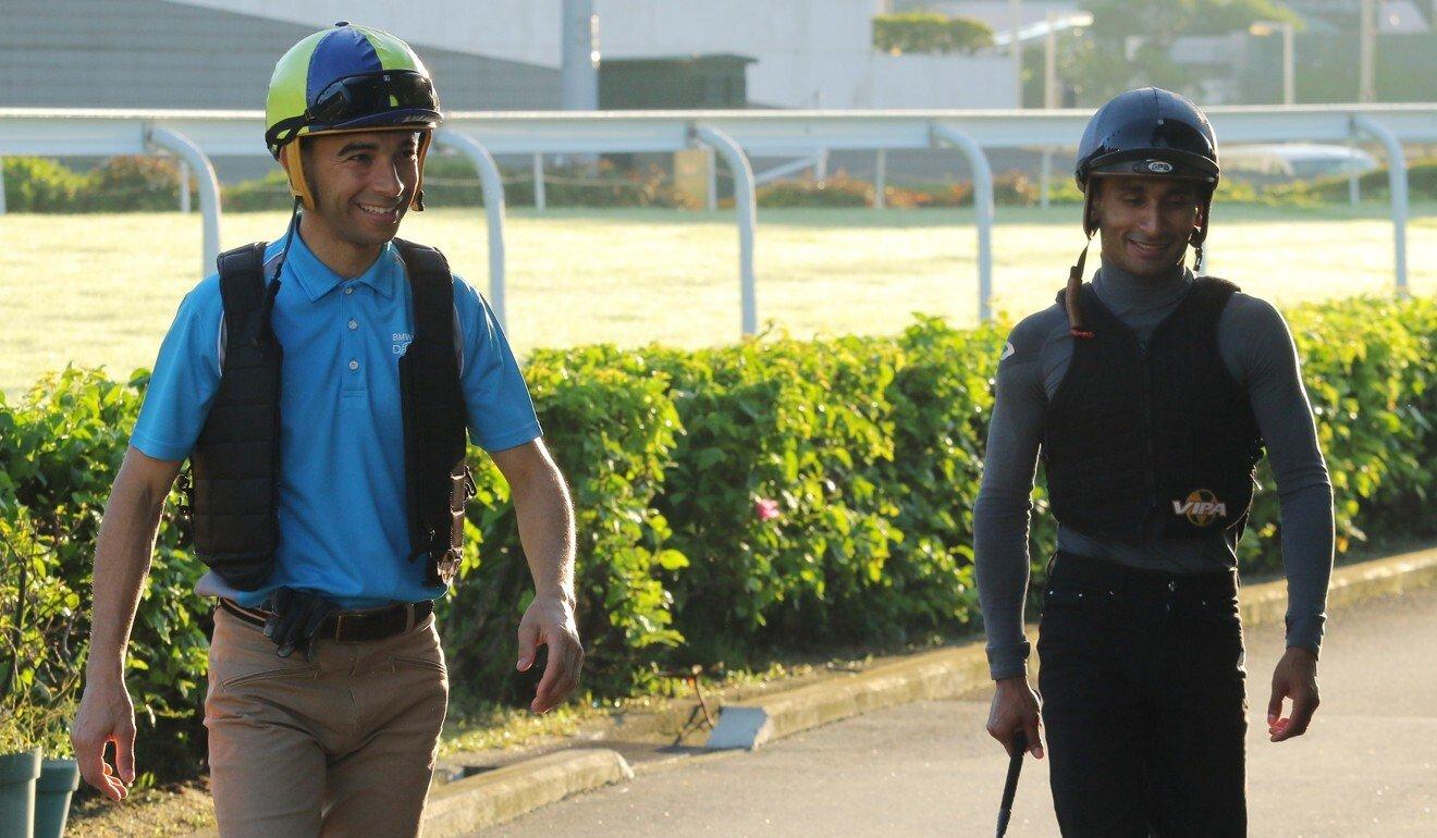 Joao Moreira and Karis Teetan at trackwork.