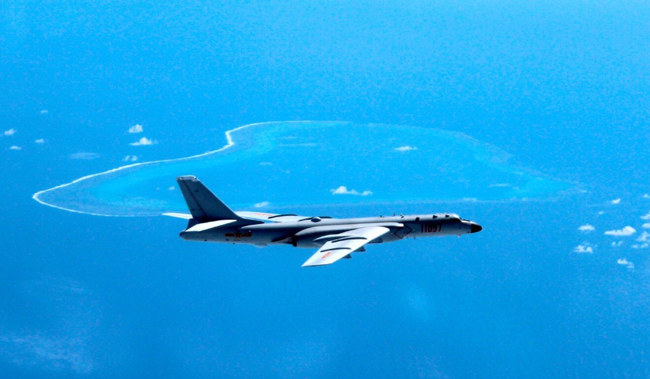 An H-6K bomber, or China's B-52, flies over the South China Sea. Photo: AP