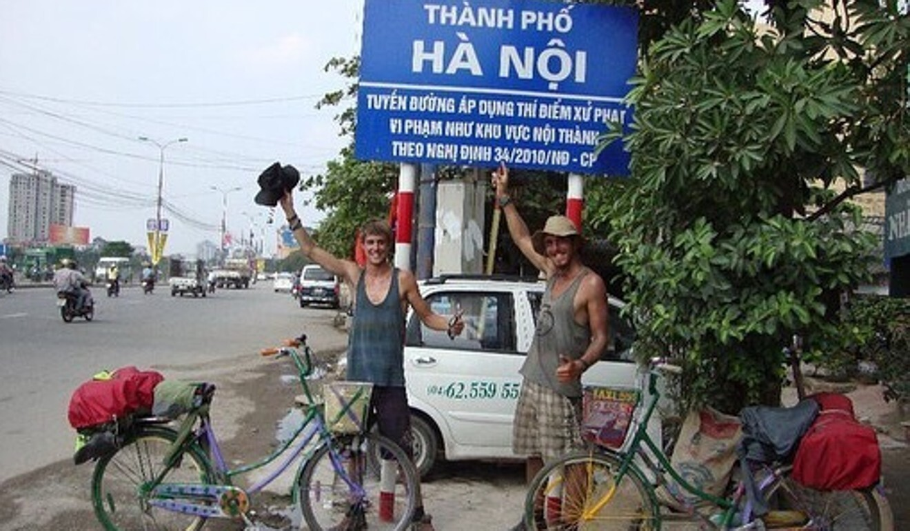 Dykes and Norman in Vietnam after biking thousands of kilometres. Photo: Handout