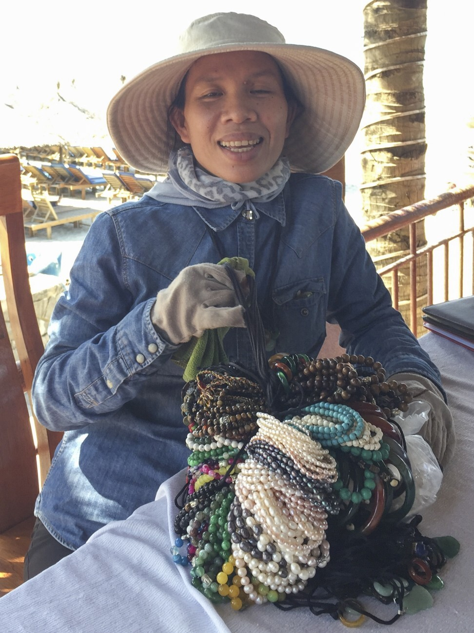 Bracelet seller Pham Thi Thu Xiem has returned to work at An Bang Beach in Hoi An. Photo: Patrick Scott