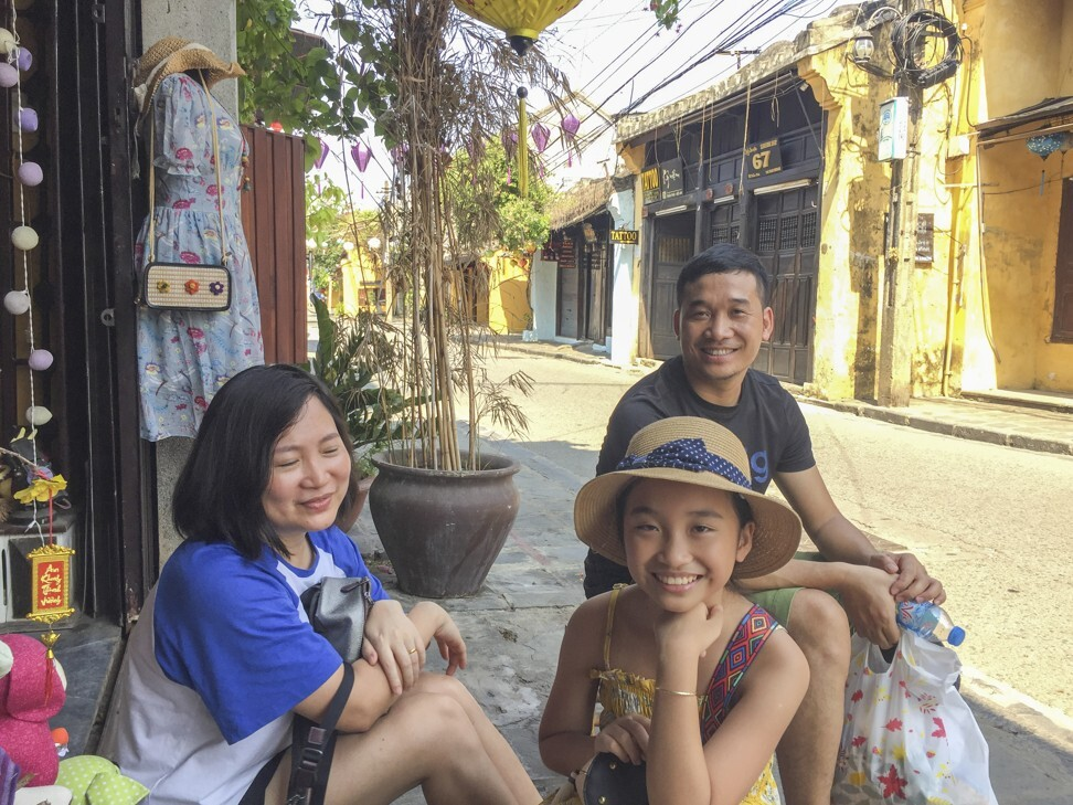A family from Hanoi shops in mostly empty Hoi An Ancient Town. Photo: Patrick Scott