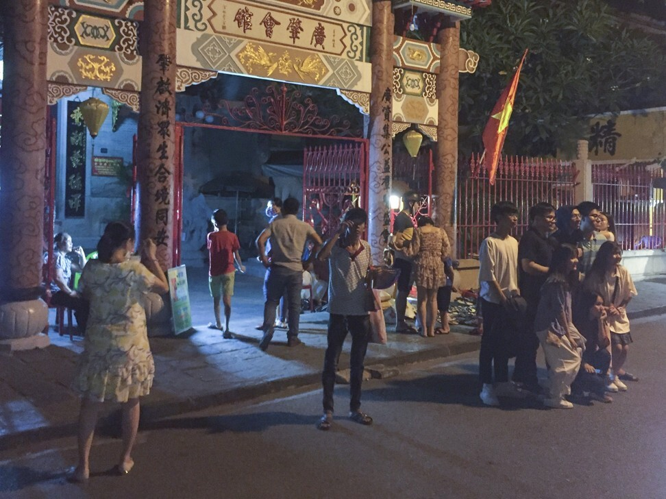 Vietnamese visitors crowded into Hoi An Ancient Town after movement restrictions were lifted. Photo: Patrick Scott