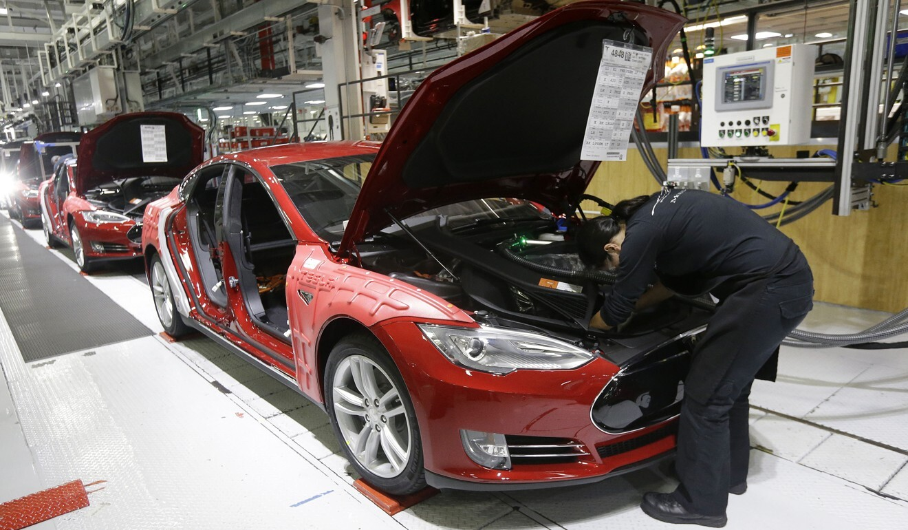 Tesla employees work on Model S cars in the Tesla factory in Fremont, California, in May 2015. Photo: AP