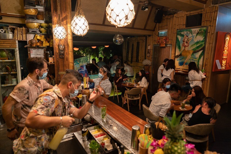 Customers gather at a bar in the Lan Kwai Fong nightlife area in Hong Kong on May 8 after curbs on social gathering were loosened. Photo: Bloomberg