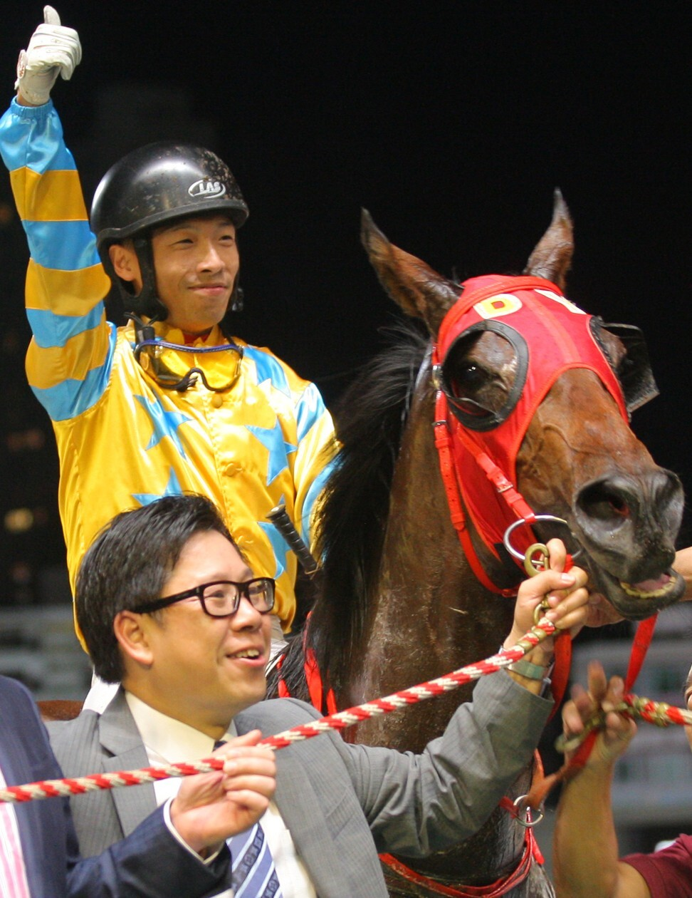 Jockey Ben So and trainer Dennis Yip celebrate the victory which handed Yip the 2012-13 trainers' championship.