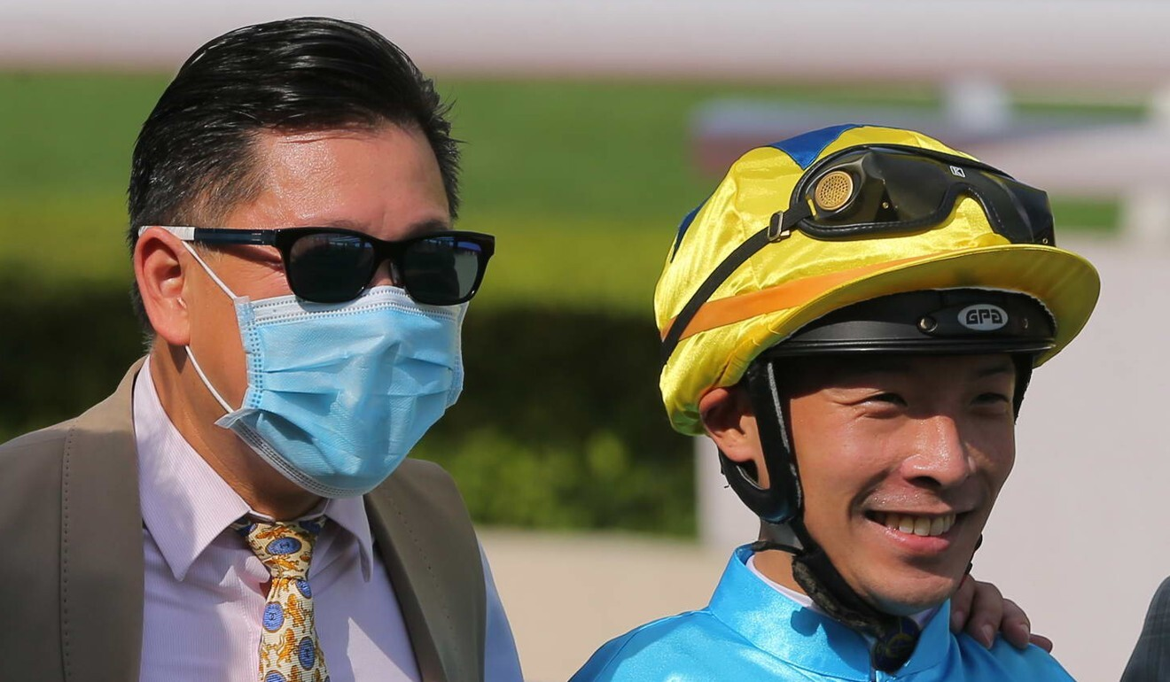 Trainer Dennis Yip and jockey Ben So celebrate their victory.