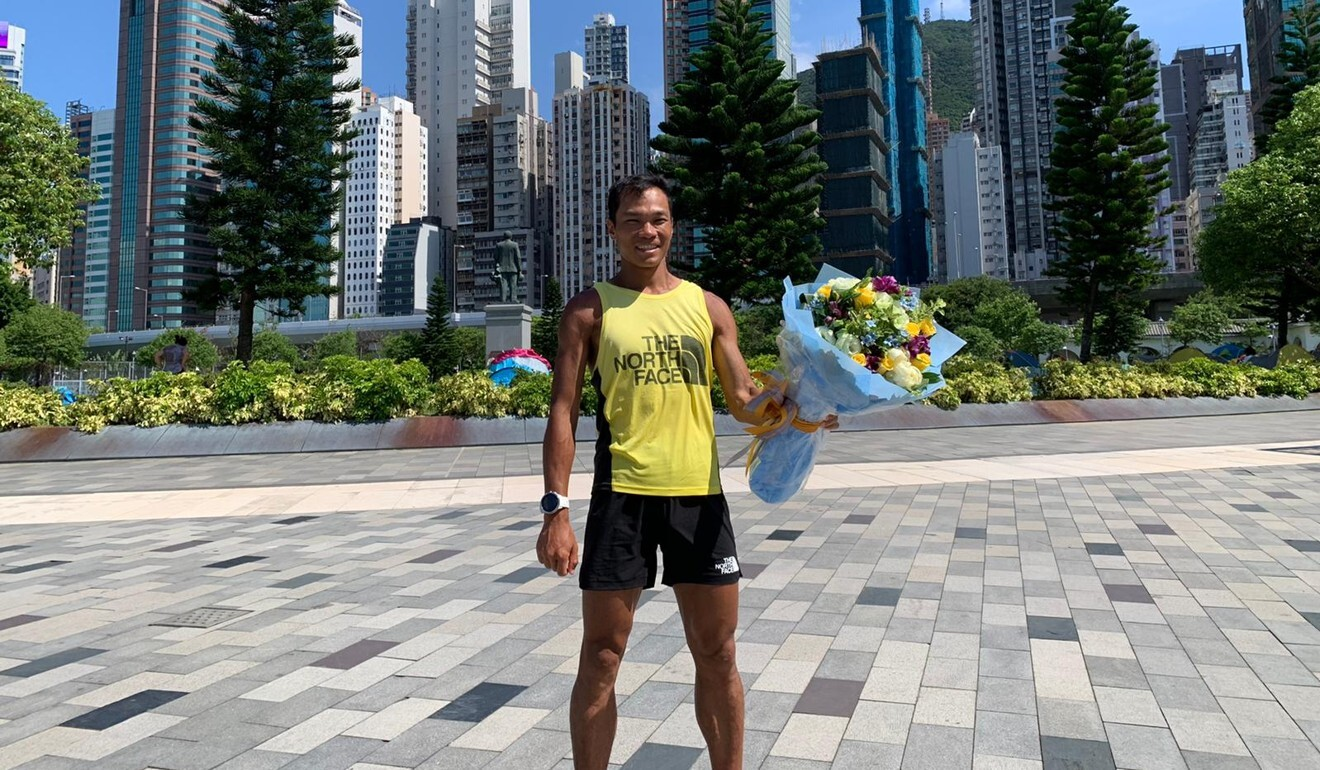A triumphant Wong Ho-chung at the end of his 360km journey.