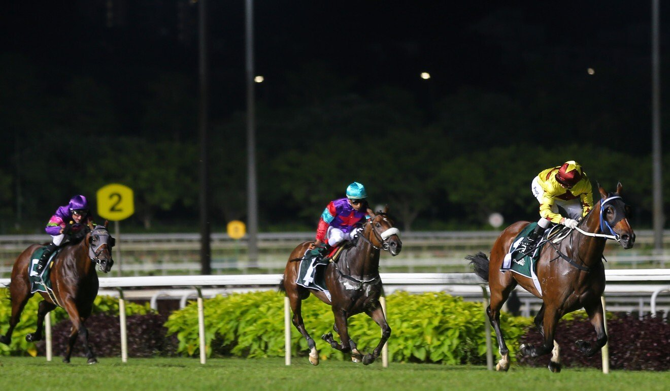 Southern Legend (right) races away with the 2019 Kranji Mile. Photo: Kenneth Chan