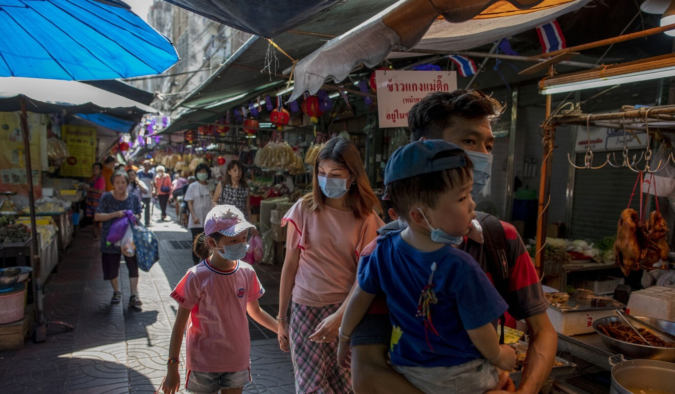 Asian tourists in Bangkok's Chinatown in February, before flights were grounded. Photo: AP