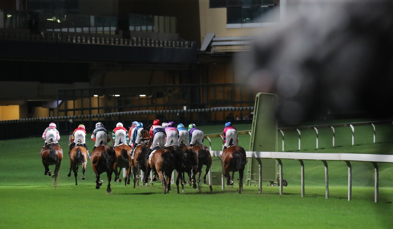 Horses race into the first turn at Happy Valley.