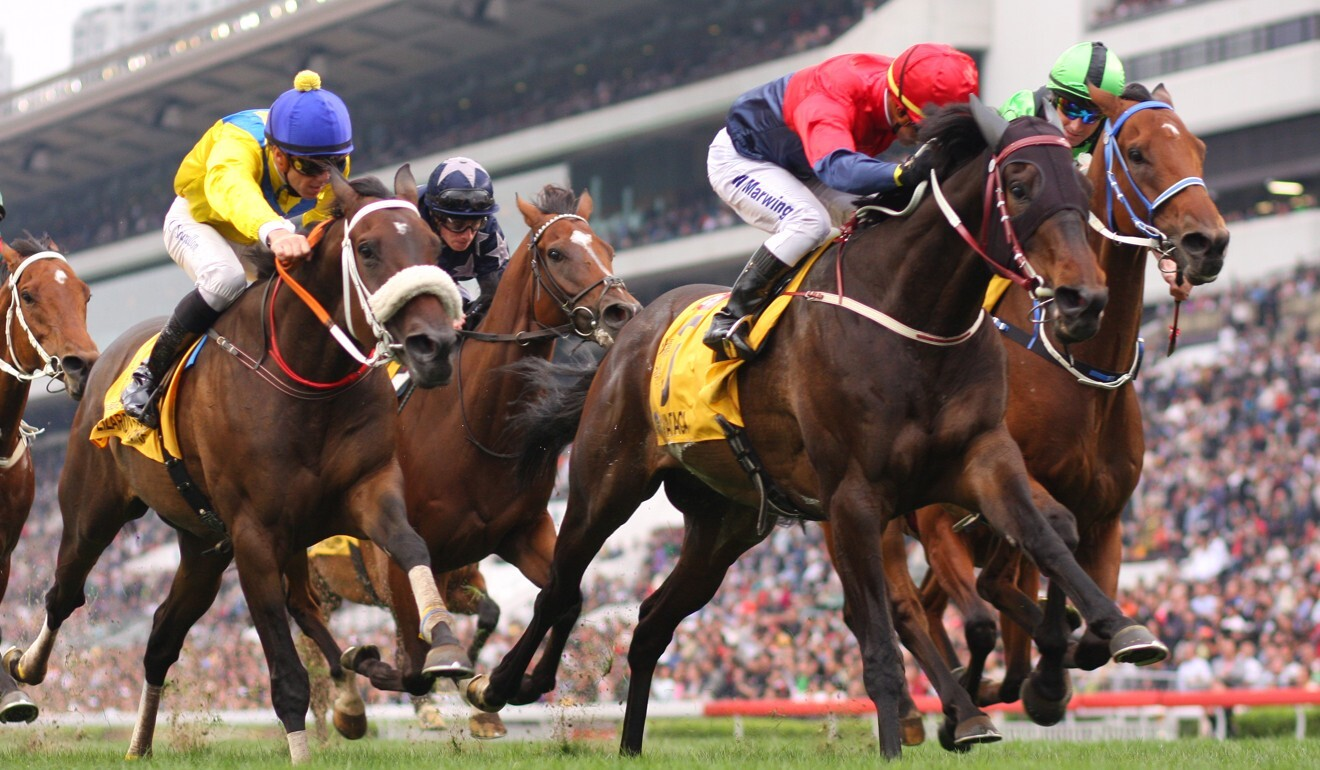 Viva Pataca (blue and red silks) wins the 2010 QE II Cup.