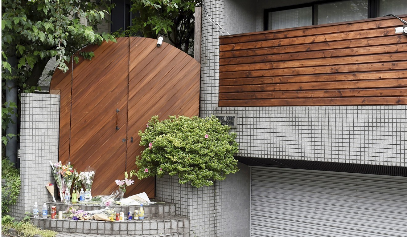 Flowers are placed at a shooting location for the Netflix reality show Terrace House in Tokyo after the death of cast member Hana Kimura. Photo: Kyodo