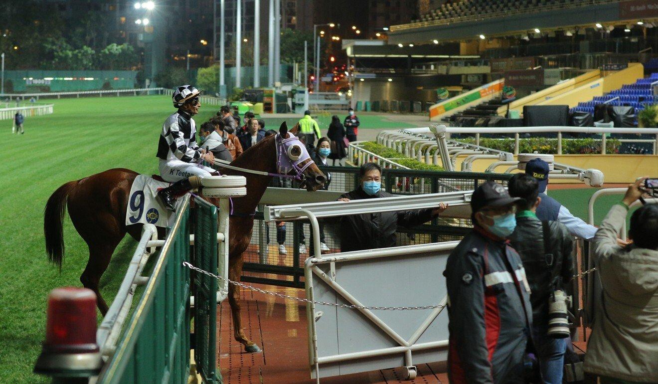 Karis Teetan returns to an empty crowd after winning a race at Happy Valley.