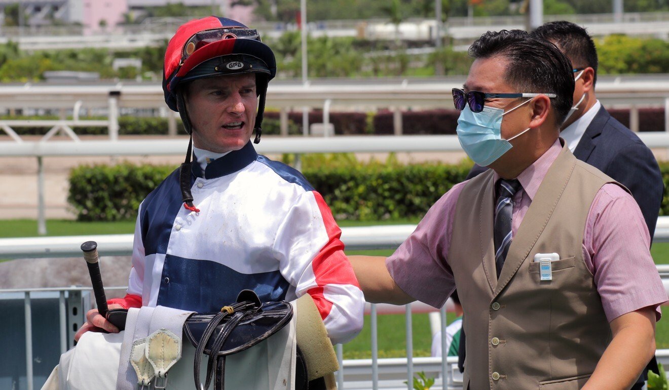 Dennis Yip with jockey Zac Purton after Racing Fighter's victory.