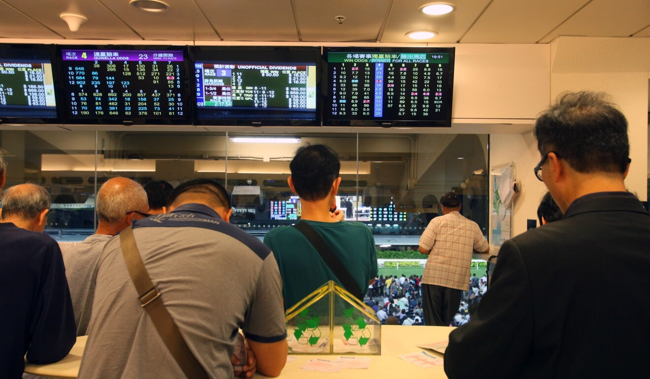 Punters betting at Happy Valley.