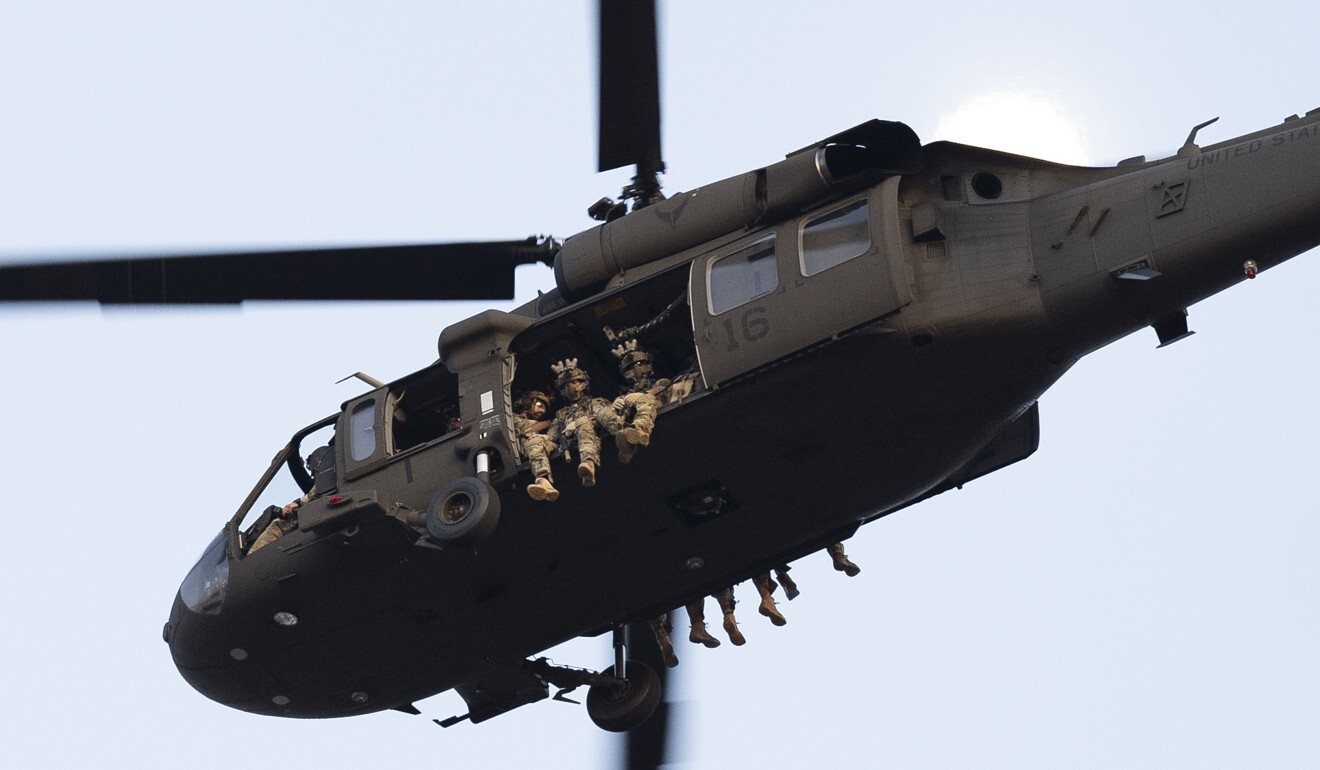 A military helicopter flies over the National Mall in Washington. Photo: DPA