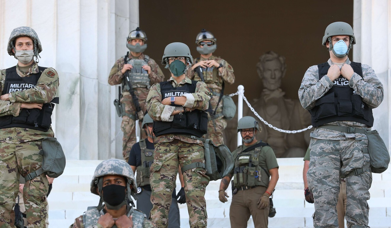 Members of the DC National Guard stand on the steps of the Lincoln Memorial in Washington. Photo: AFP
