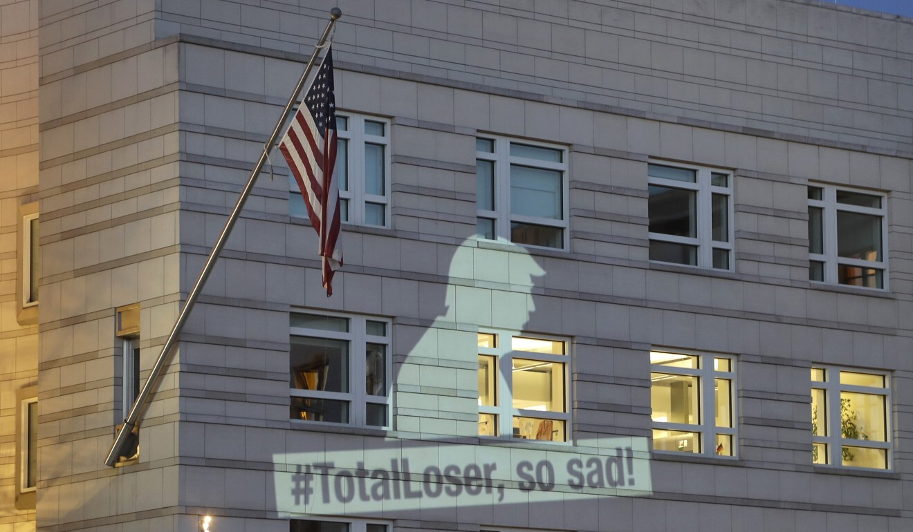 A Greenpeace message projected onto the facade of the US embassy in Berlin in 2017, after Donald Trump declared he was pulling the US from the Paris climate agreement. File photo: EPA