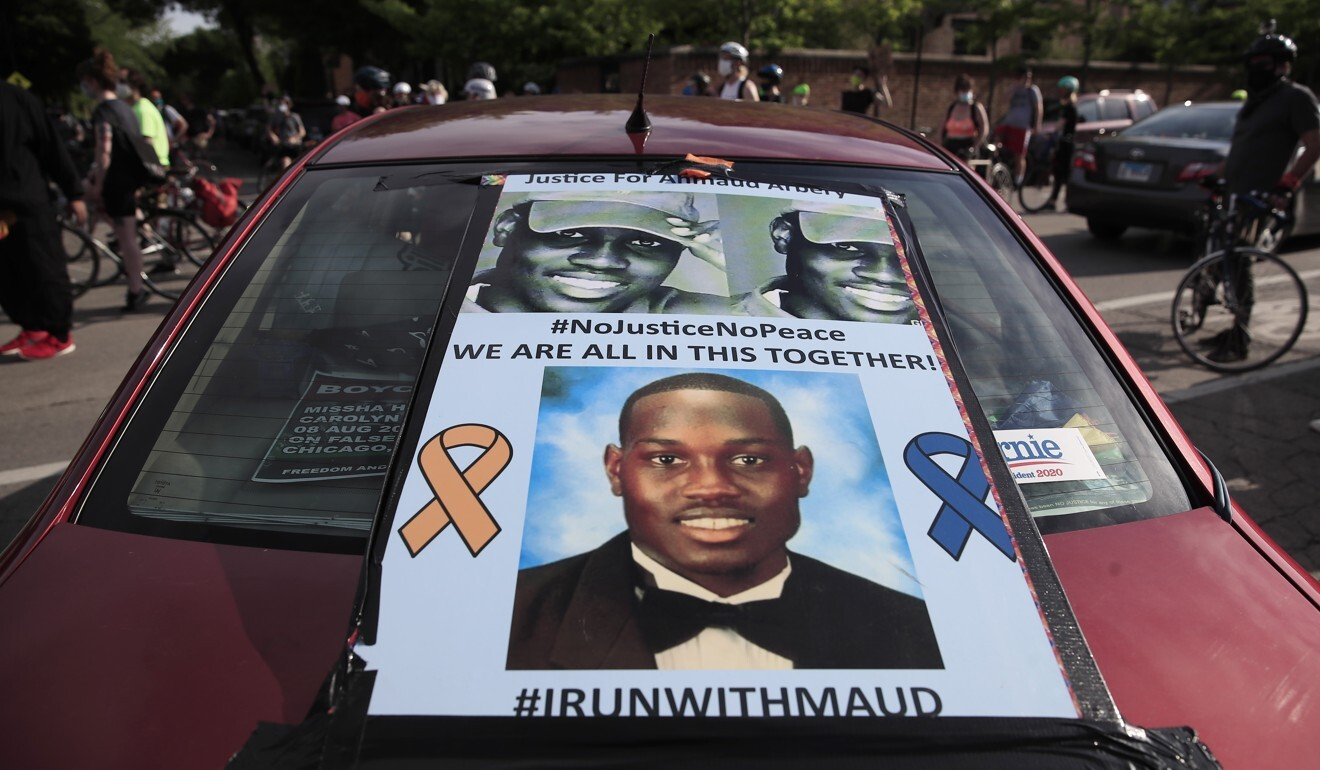 An Ahmaud Arbery poster is seen on a car during a George Floyd demonstration in Chicago on Thursday. Photo: EPA-EFE