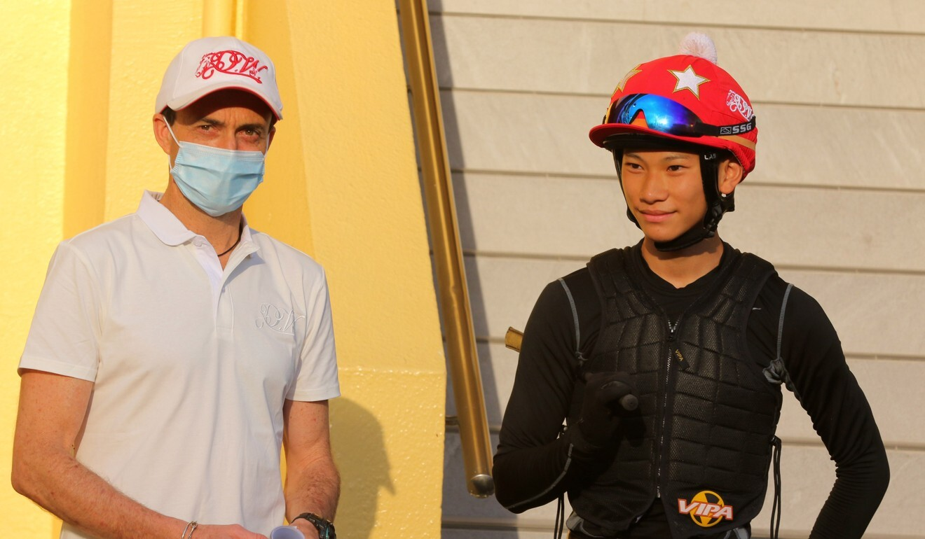 Trainer Douglas Whyte and his apprentice Jerry Chau at the Happy Valley trials last month.