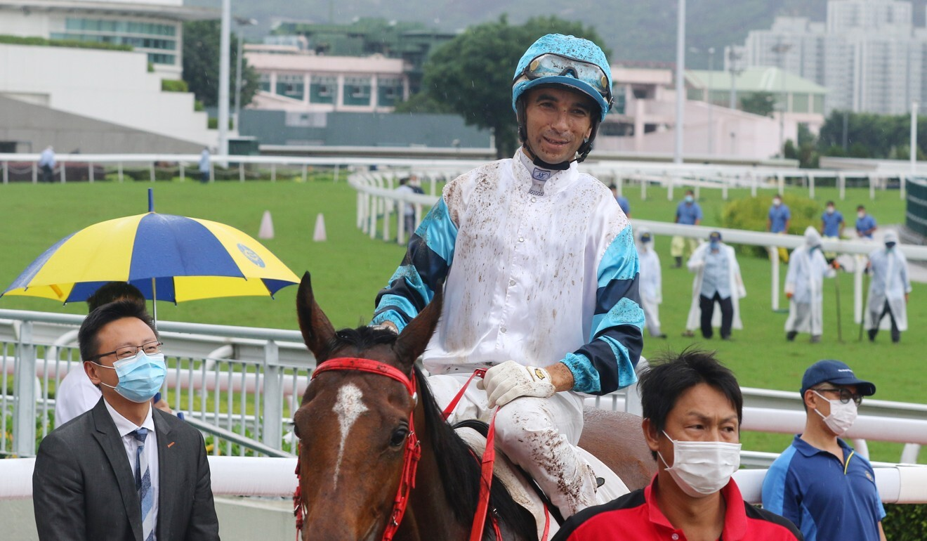 Joao Moreira returns covered in mud after winning on Leap Of Faith at Sha Tin yesterday.