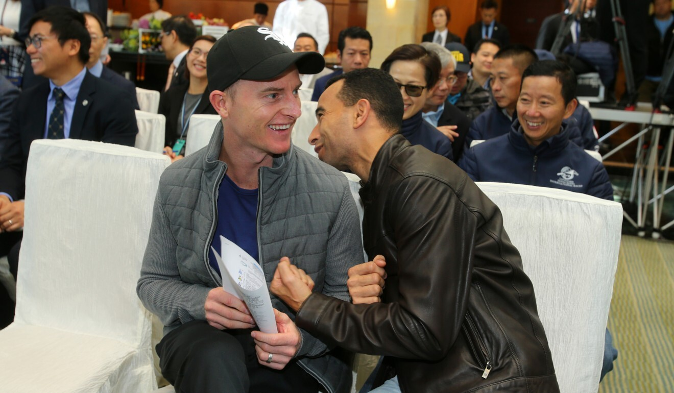 Zac Purton and Joao Moreira share a joke before the draw for the International Jockeys' Championship in December.