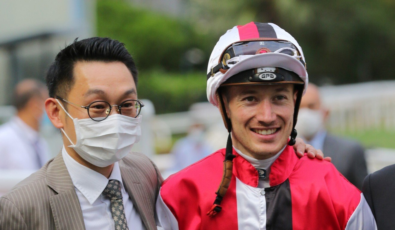 Trainer Jimmy Ting and jockey Antoine Hamelin celebrate after winning with Assimilate.