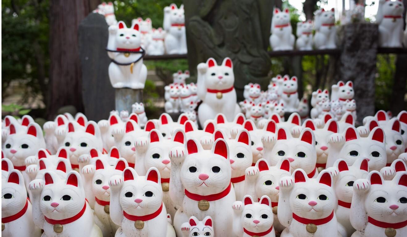 Cat figurines called