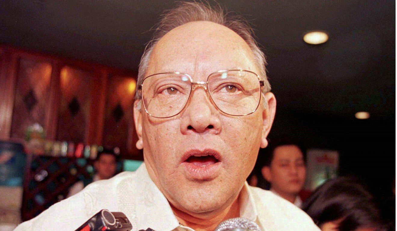 Eduardo Cojuangco talks to reporters in 1998 after he returned as chairman of San Miguel Corporation. Photo: Reuters