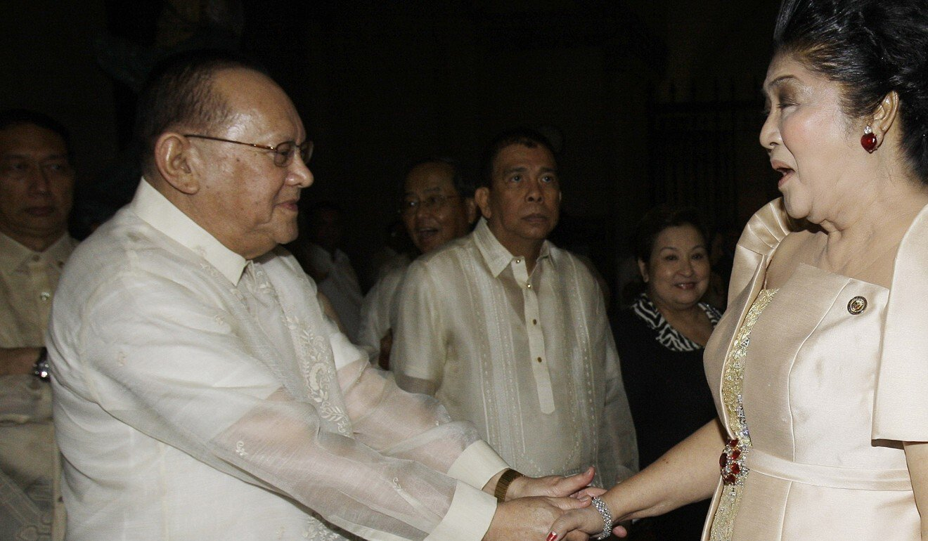 Eduardo Cojuangco Jnr., left, greets then-congresswoman Imelda Marcos, the widow of the late strongman Ferdinand Marcos, in 2011. Photo: AP