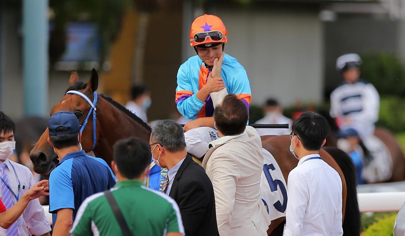 Trainer Caspar Fownes congratulates jockey Keith Yeung.