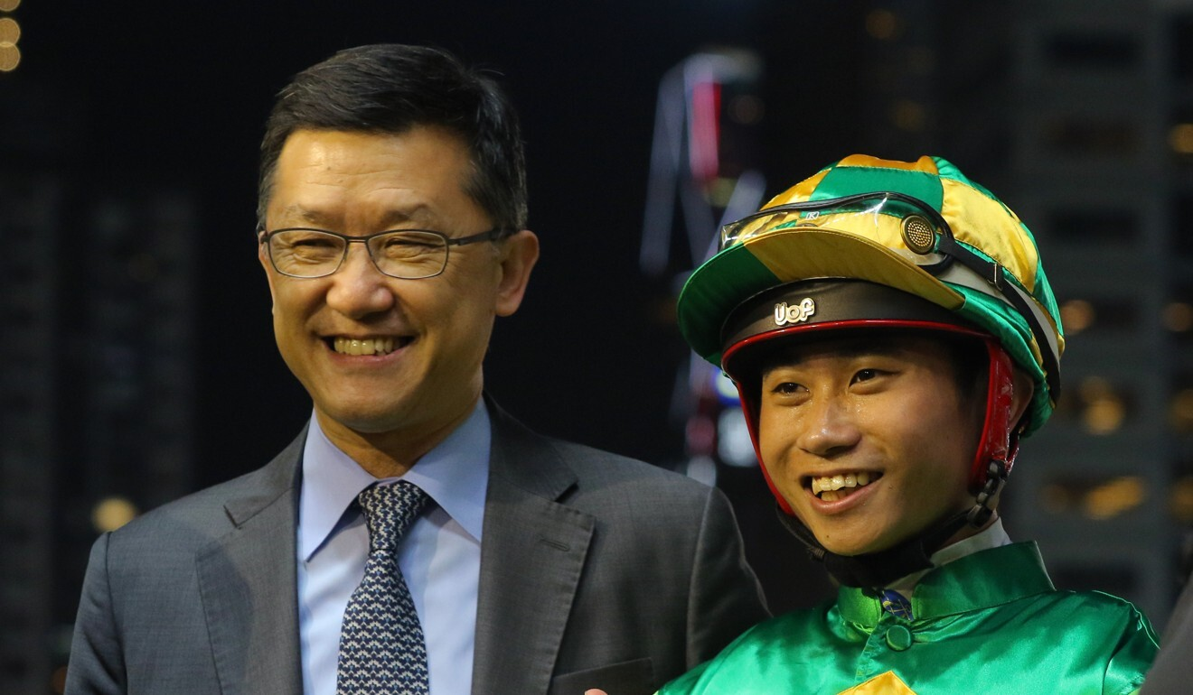 Trainer Peter Ho and jockey Dylan Mo celebrate a winner earlier this season.
