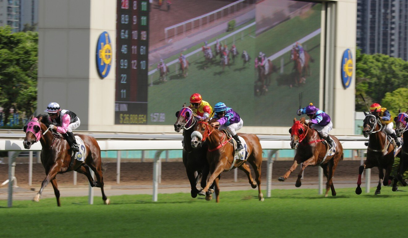 Beauty Happy holds on to win at Sha Tin on Saturday.
