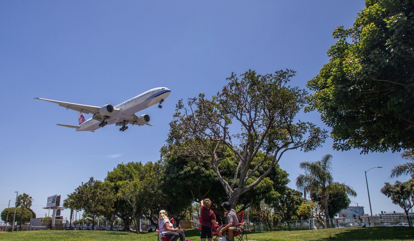 A China Airlines plane lands at LAX airport in Los Angeles, California in May. Long-haul travel has plunged, and forward demand for tickets is drastically lower than a year ago. Photo: Apu Gomes/AFP via Getty Images