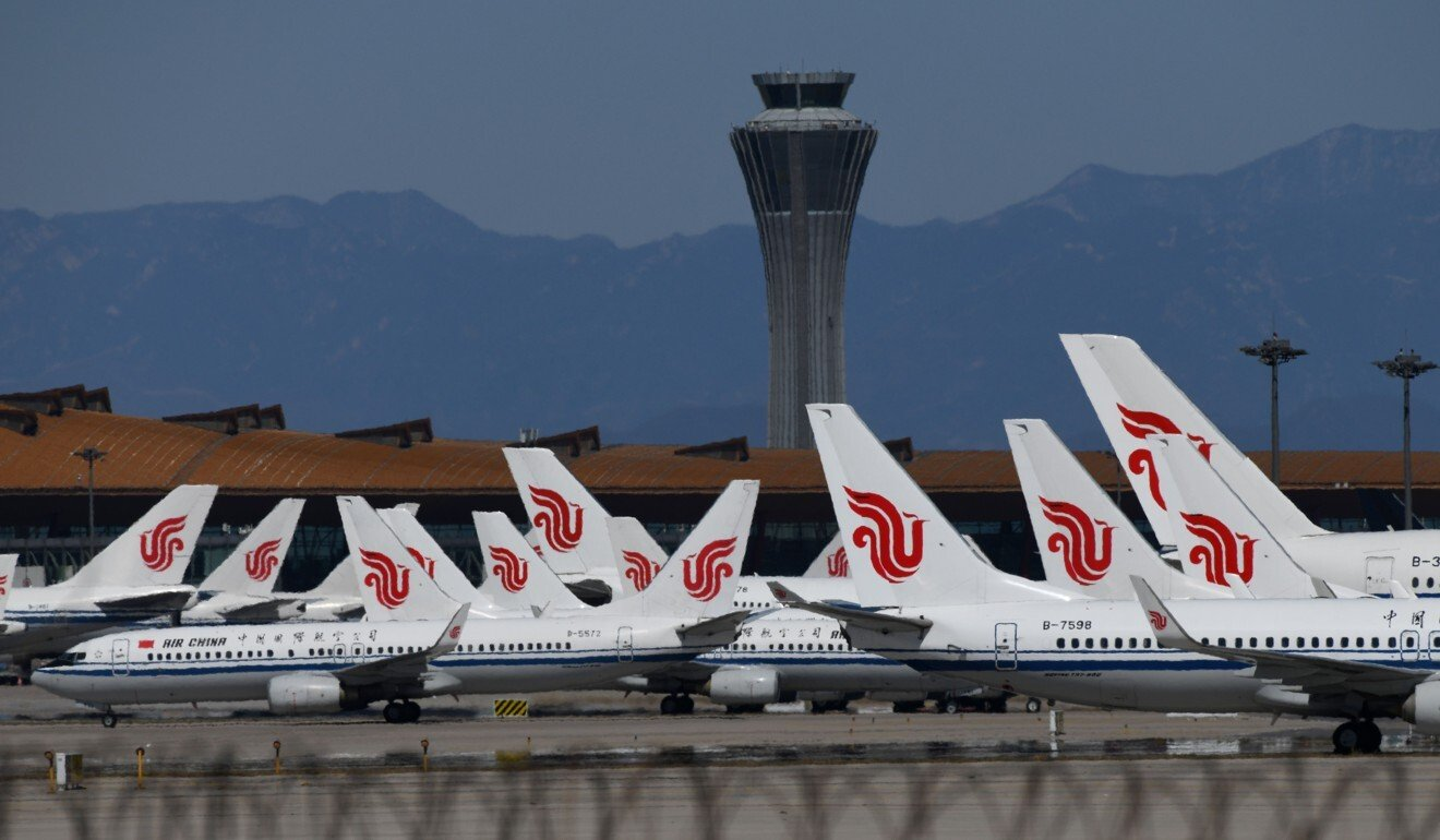 Planes on the tarmac at Beijing Capital International Airport. Photo: Greg Baker/AFP via Getty Images