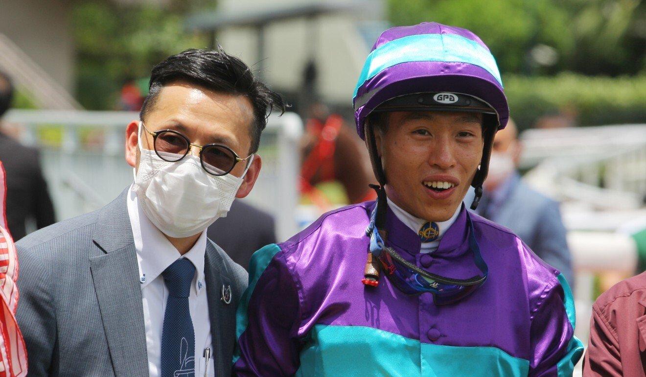 Trainer Frankie Lor and jockey Vincent Ho celebrate Winning Dreamer's victory.