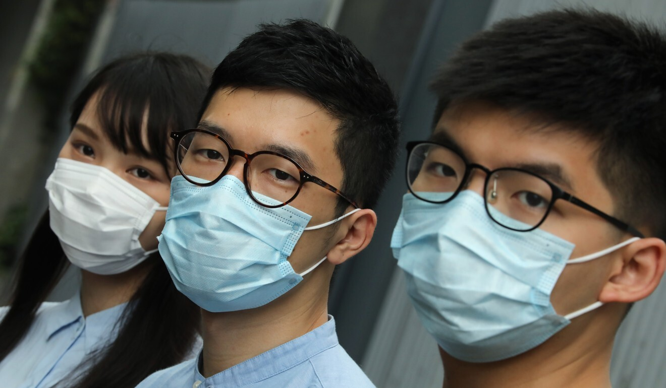 Nathan Law (centre), seen with fellow activists Agnes Chow and Joshua Wong, testified via video conference for the US Congress' House Foreign Affairs Committee on Wednesday, an act that could put him afoul of the new national security law. Photo: K.Y. Cheng